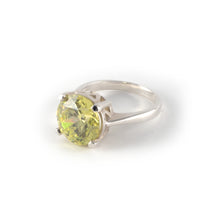 Round Crown Low Ring with a peridot crystal set in sterling silver ring.