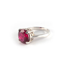Round Crown High Ring with a red ruby crystal set in sterling silver.