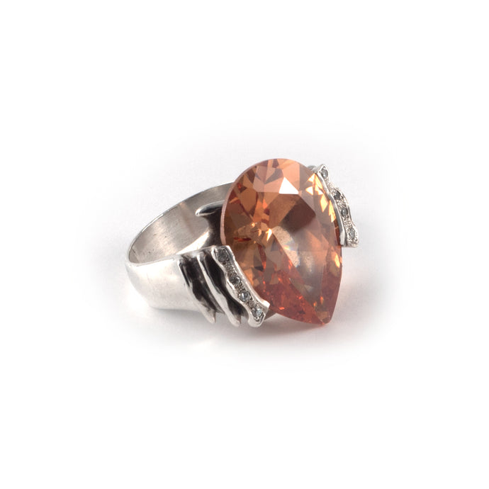 Wave Ring with a champagne topaz crystal and diamond crystal on waves set in sterling silver.