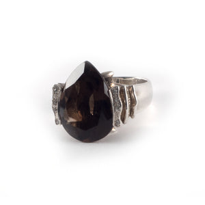 Wave Ring with a smokey quartz gemstone and diamond crystals on the waves, set in sterling silver.