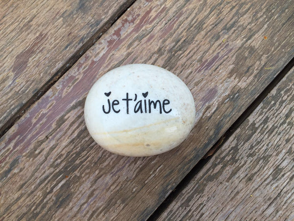 "Located in Bangalore, Tile Italia Pebbles is the best option for you to buy engraved pebbles! This pebble-""Je t'aime"" make great gifts for Mother's day, Father's day, Valentine's Day, Friendship day, Anniversaries and birthdays! They make the perfect gift for your loved ones. They require low maintenance and are cheap and reasonable."