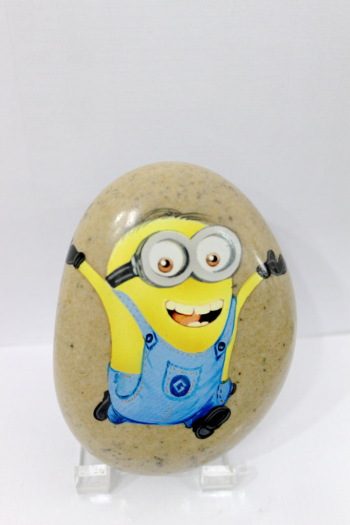 Located in Bangalore, Tile Italia Pebbles is the best option for you to buy painted pebbles! We are India's leading supplier and wholesale dealers in pebbles. This Painted Pebble Minion is great for interiors, landscaping and garden décor. Quirky and colourful they are great as gifts for every occasion. They require low maintenance and are cheap and reasonable. They easily fit into your home décor and enhance beauty of any place.