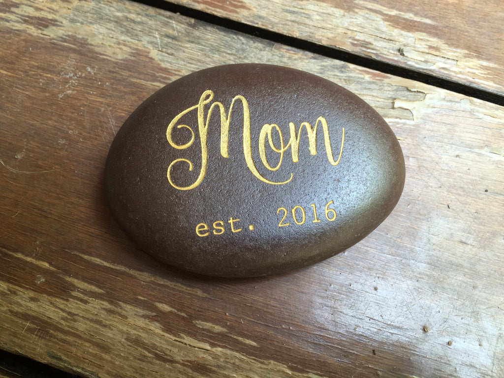 "Located in Bangalore, Tile Italia Pebbles is the best option for you to buy engraved pebbles! This pebble-""Mom est. 2016"" make great gifts for Mother's day, Father's day, Valentine's Day, Friendship day, Anniversaries and birthdays! They make the perfect gift for your loved ones. They require low maintenance and are cheap and reasonable."