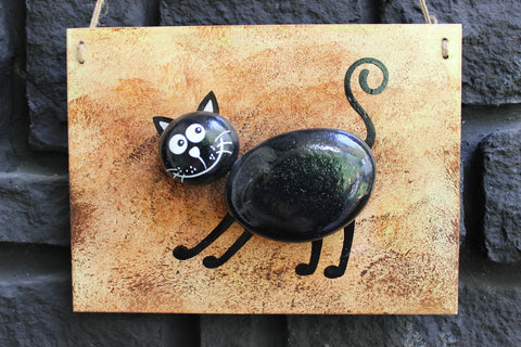 Located in Bangalore, Tile Italia Pebbles is the best option for you to buy painted pebbles! We are India's leading supplier and wholesale dealers in pebbles. This Painted Pebble Portrait- Cat is great for interiors, landscaping and garden décor. Quirky and colourful they are great as gifts for every occasion. They require low maintenance and are cheap and reasonable. They easily fit into your home décor and enhance beauty of any place.