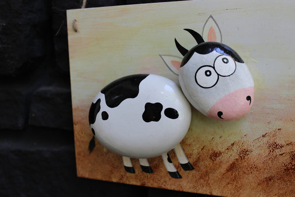 Located in Bangalore, Tile Italia Pebbles is the best option for you to buy painted pebbles! We are India's leading supplier and wholesale dealers in pebbles. This Painted Pebble Portrait- Cow is great for interiors, landscaping and garden décor. Quirky and colourful they are great as gifts for every occasion. They require low maintenance and are cheap and reasonable. They easily fit into your home décor and enhance beauty of any place.
