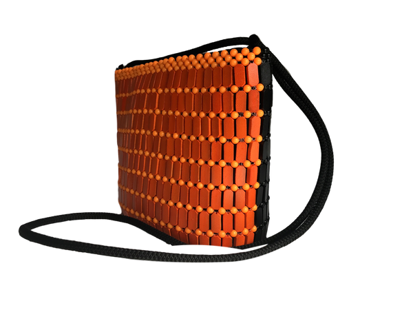 Mendocino_style_black_and_orange_two-tone_wooden_beaded_crossbody_bag_from_Kenya_at_Kupendiza