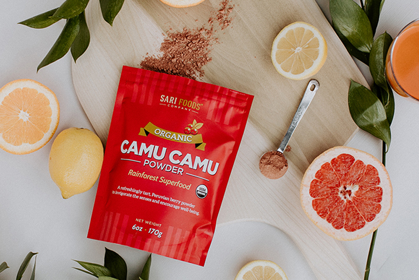 Camu Camu powder and citrus fruits.