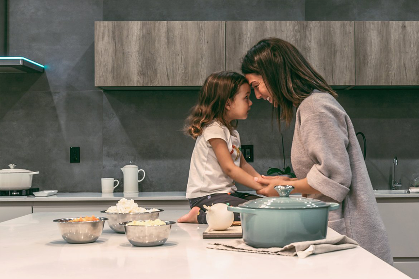 Mom and daughter in kitchen.