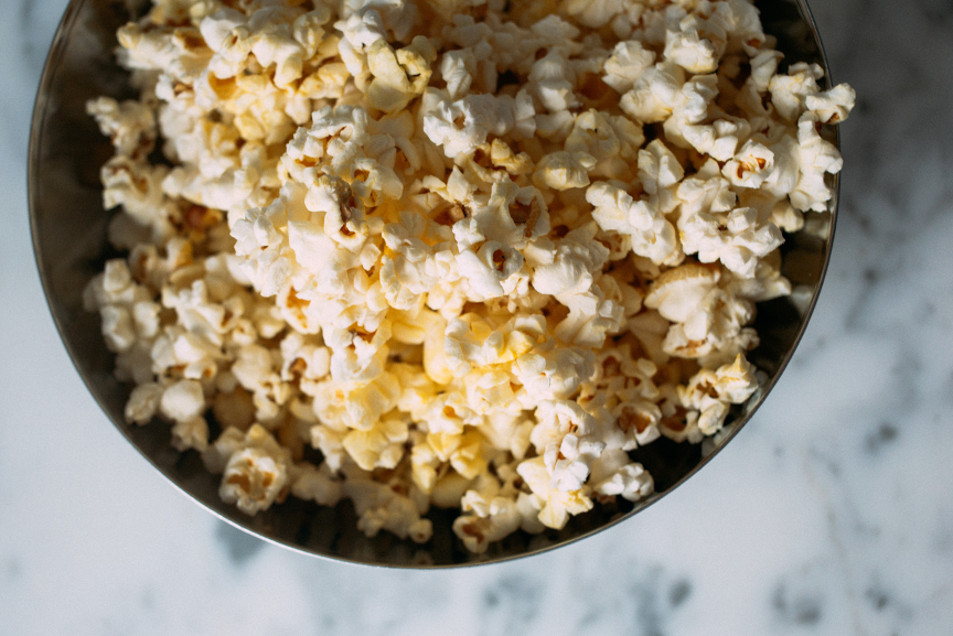 Bowl of nutritional yeast dusted popcorn