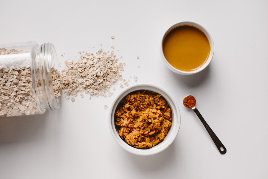 Acacia fiber and turmeric with oats in a bowl.