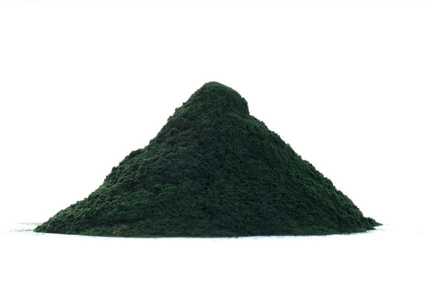 Spirulina powder on a white background
