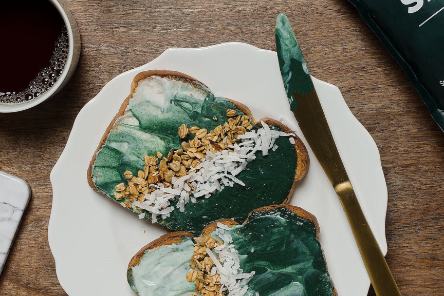 Two pieces of Spirulina toastier on a plate