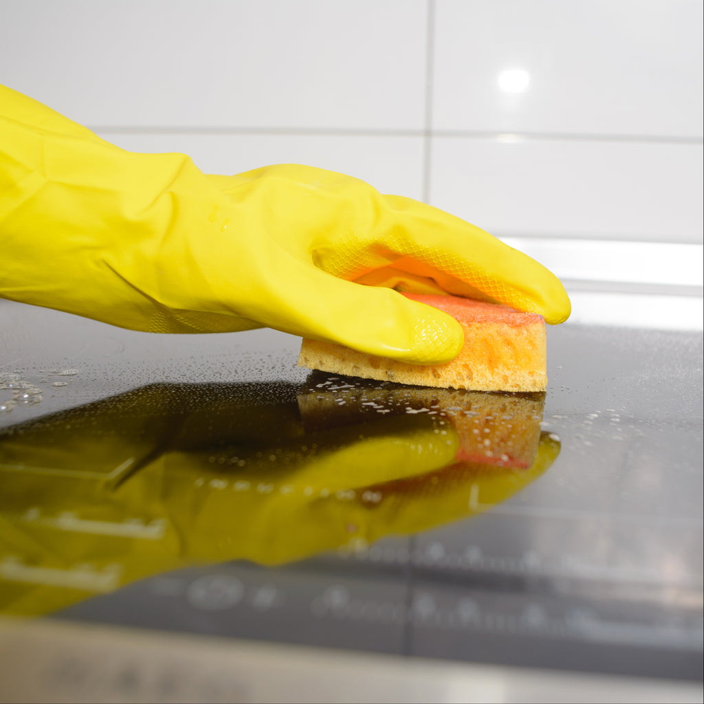 wiping down surface with sponge
