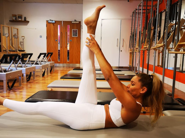 Use This Pilates Workout At Home To Strengthen Your Core