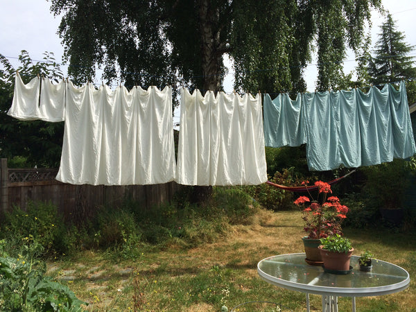 rough linens clotheslines soft beautiful breezy laundry bedding flowers backyard