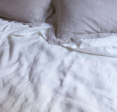 closeup detail of 100% linen lightweight bedroom bed coverlet blanket throw off-white color