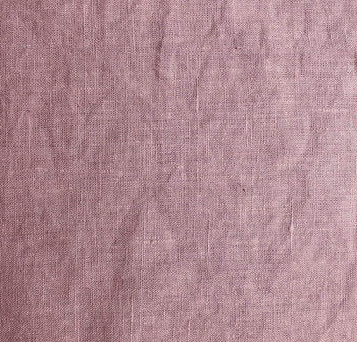 closeup detail of 100% linen body pillow cover heavyweight Orkney linen fabric rose light pink color
