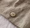 all natural un-dyed flax linen bedding with natural coconut button closure.