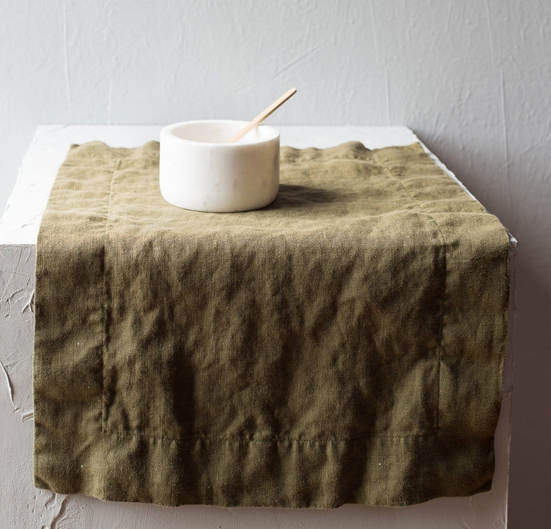dining table scene with 100% linen placemat mid-weight linen limited edition moss green color