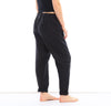 woman wearing 100% linen pants soft washed elasticated waistband flattering fit versatile wear pockets black color