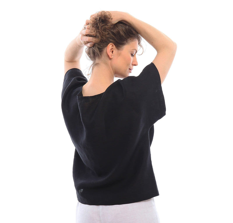 woman wearing 100% linen top blouse dolman sleeve soft pre-washed linen fabric loose-cut black color