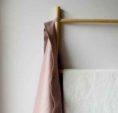detail of hanging 100% linen bath sheet heavyweight Orkney linen fabric sturdy antimicrobial large bath towel rose light pink color