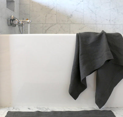 bathtub with 100% linen bath towel sturdy antimicrobial fast drying heavyweight Orkney linen fabric charcoal dark grey color