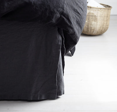 bed detail of 100% linen bedskirt heavyweight Orkney linen fabric charcoal dark grey color