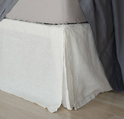 bed detail of 100% linen bedskirt heavyweight Orkney linen fabric off-white white color