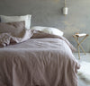 bedroom scene with 100% linen Cal King bed linens bed-in-a-bag duvet cover pillow shams bedskirt summer cover sheets rose light pink blush off-white white color