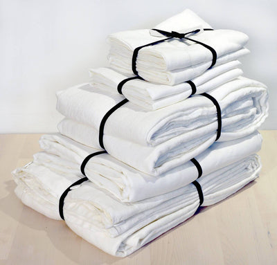 folded stack of 100% linen Cal King bed linen set bed-in-a-bag duvet cover cover pillow shams bedskirt summer cover sheets off-white white color