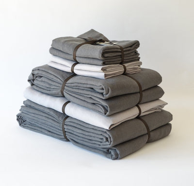 folded stack of 100% linen queen bed-in-a-bag set with duvet pillow shams summer cover flat sheets heavyweight Orkney linen fabric charcoal dark grey light grey colors