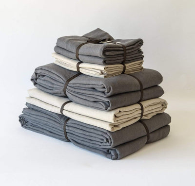 folded stack of 100% linen king bed linen set bed-in-a-bag duvet cover pillow shams bedskirt summer cover sheets natural light brown beige tan charcoal dark grey colors