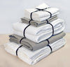 folded stack of 100% linen Cal King bed linen set  bed-in-a-bag duvet cover pillow shams bedskirt summer cover sheets off-white white natural beige light brown tan colors