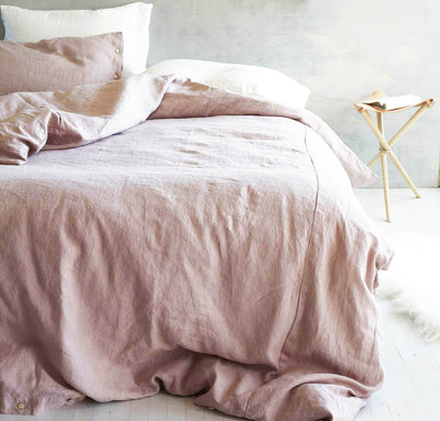 bedroom scene with 100% linen duvet cover heavyweight Orkney linen fabric bed comforter rose light pink blush color
