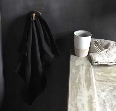 bathroom scene of hanging 100% linen hand towel heavyweight Orkney linen fabric antimicrobial fast drying black color
