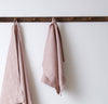 bathroom scene of hanging 100% linen hand towel heavyweight Orkney linen fabric antimicrobial fast drying rose light pink blush color