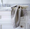 bathroom scene with 100% linen hand towel heavyweight Orkney linen fabric antimicrobial fast drying natural light brown beige tan color