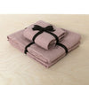 folded stack of 100% linen powder room towel set hand towels wash cloths heavyweight Orkney linen fabric antimicrobial fast drying light pink rose blush color