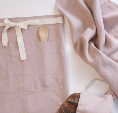 scene with 100% linen apron bread bag and tea towel heavyweight Orkney linen fabric light pink rose blush color