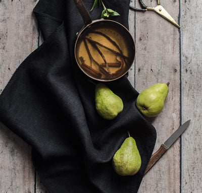 black linen dish towel tea towel poaching green pears with vanilla