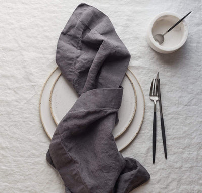 dining table scene with 100% linen napkins heavyweight Orkney linen fabric charcoal color