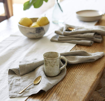 dining table scene with 100% linen napkins heavyweight Orkney linen fabric natural light brown beige tan color