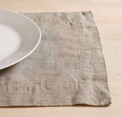 closeup detail of 100% linen placemat heavyweight Orkney fabric natural light beige brown tan color