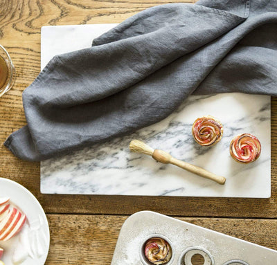 charcoal grey linen kitchen towel with mini apple rose tarts. fine linen tea towel dark gray