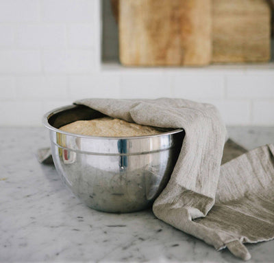 all natural linen kitchen towel draped over bowl of rising dough. tea towel in natural flax linen