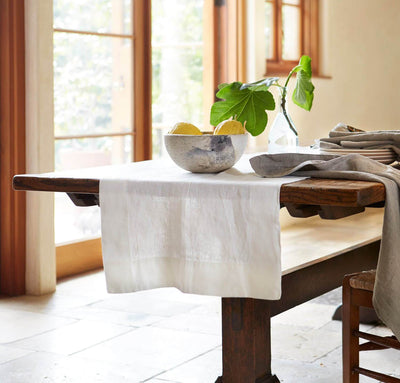 white linen table runner on rustic oak table, natural quality table linens