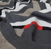 closeup detail of 100% linen quilt bed blanket cover throw with smooth linen fabric cotton fill patterned design black charcoal dark grey white natural beige red colors