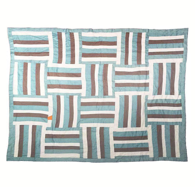 bedroom scene with 100% linen quilt bed blanket cover throw with smooth linen fabric cotton fill patterned design sea green aqua natural off-white colors