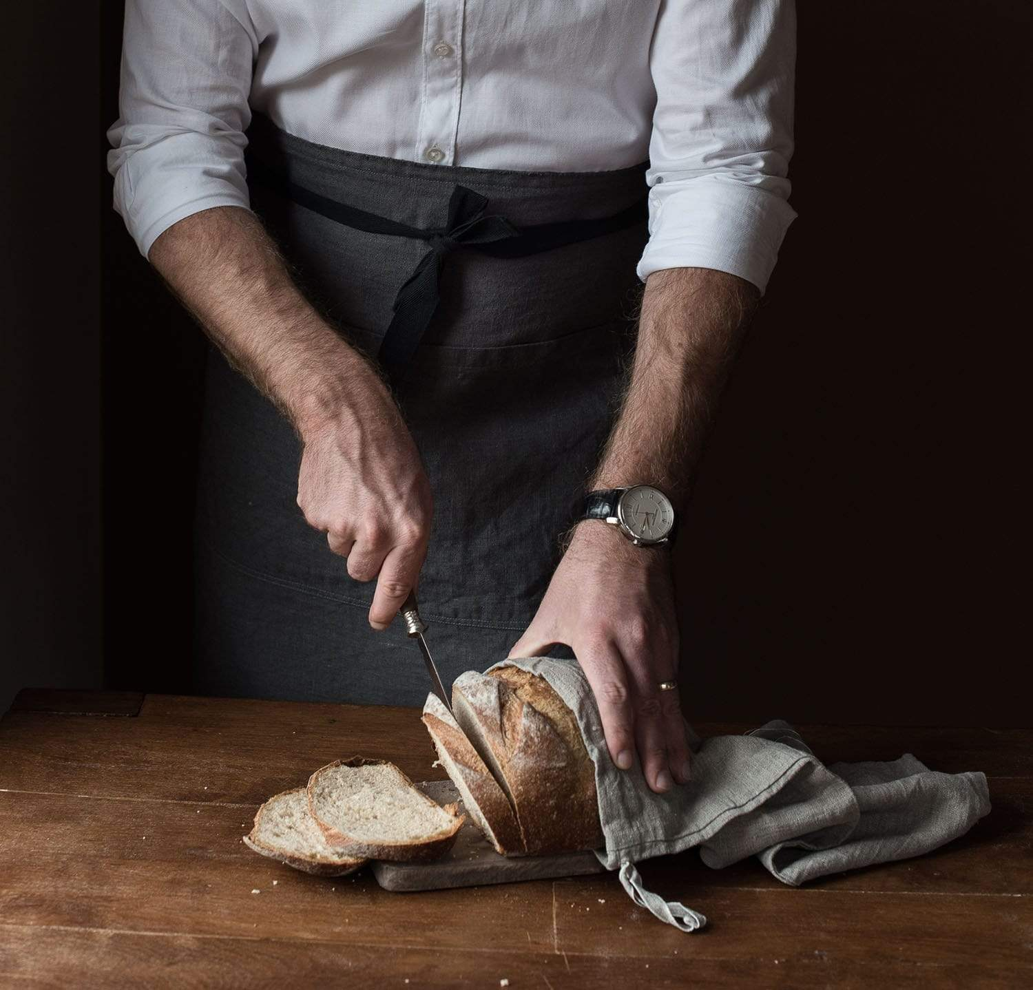 man wearing 100% linen apron heavyweight Orkney linen fabric charcoal dark grey color